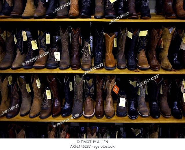 Cowboy boots on shelves for sale; Las Vegas, Nevada, United States of America