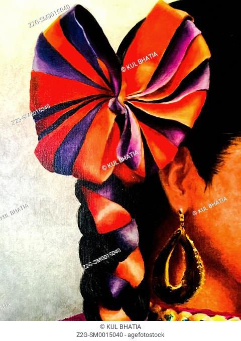 Big, round, ribbon and dangling earring, closeup