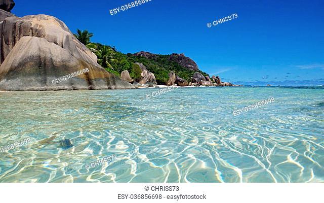 bizarre granite rocks on tropical beachon la digue