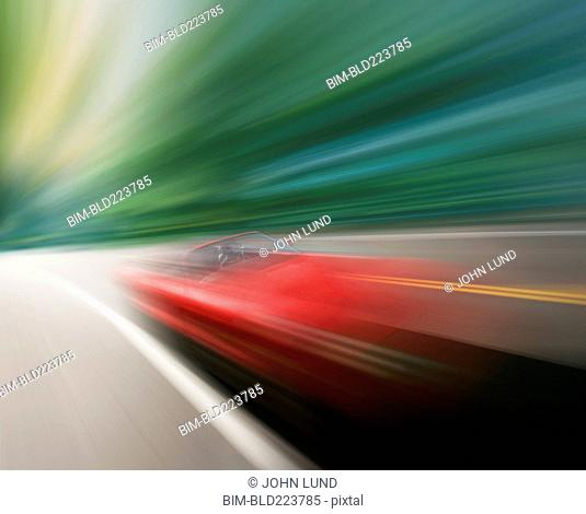 Blurred view of speed red sports car