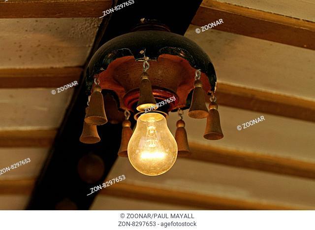 Tungsten filament light bulb in antique fitting , Munich Upper Bavaria Germany