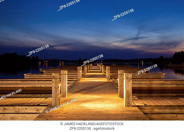 A pier at sunset at the harbour in Gravenhurst, Muskoka, Ontario, Canada