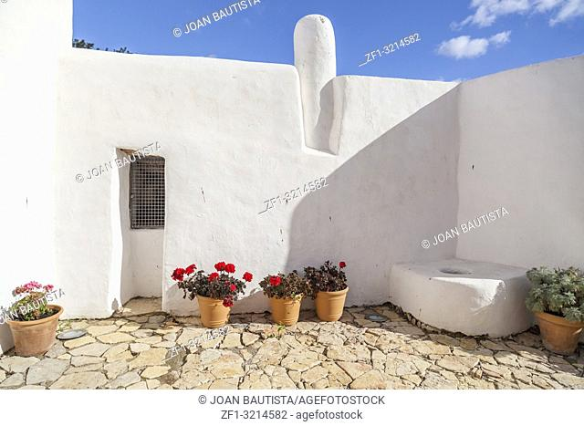Ancient house and windmill Can Planetes,nowadays is cultural and ethnographic center. Santa Eularia des Riu, Ibiza, Spain