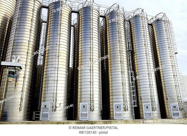 Large stainless steel tanks containing plastic ingredients for extrusion industry