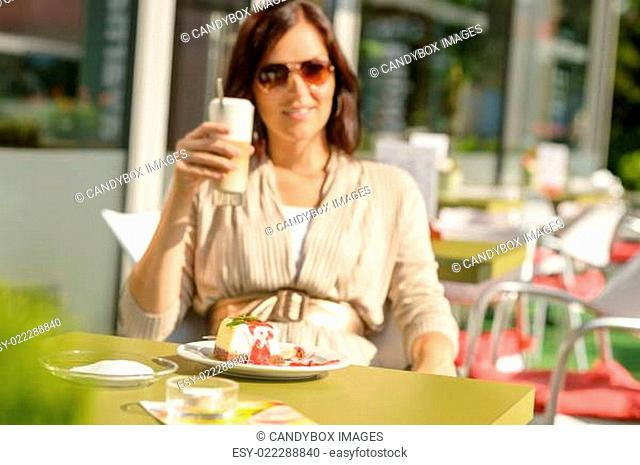 Woman drinking latte at cafe bar dessert