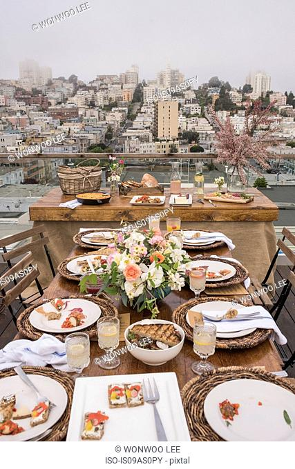 Table with empty plates, on balcony, North beach San Francisco, California, USA