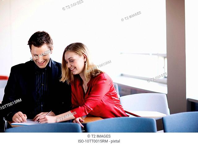 Man and woman working on a file