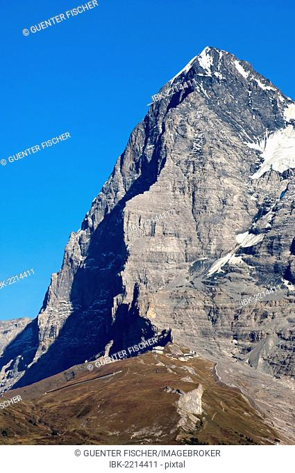Eiger mountain, Eiger's north face in the shadow, as seen from the west, Eigergletscher station of the Jungfrau-Bahn train at the foot of the mountain
