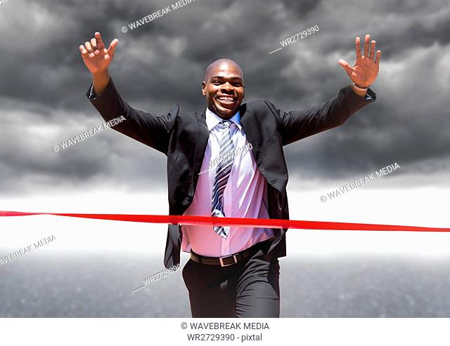 Excited businessman crossing the finish line