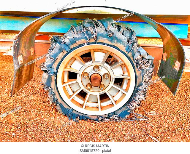 Shredded and flat trailer tyre on a dirt road in the Australian Outback