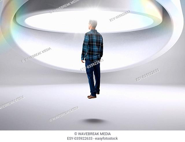 Man being abducted by aliens spacecraft