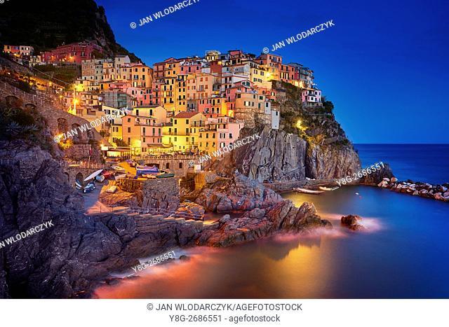 Manarola at evening dusk, Riviera de Levanto, Cinque Terre, Liguria, Italy