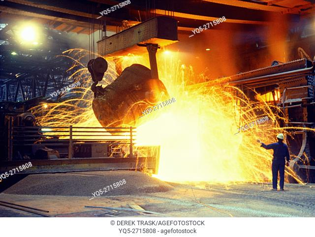 smelter, smelting iron ore, adding molten pig iron from blast furnace