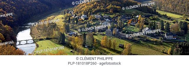 Aerial view over the village Frahan surrounded by the meandering Semois river seen from Rochehaut in the Belgian Ardennes in autumn, Wallonia, Belgium