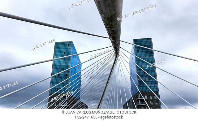 Zubizuri bridge and Isozaki Atea Towers. Bilbao, Bizkaia, Basque Country, Spain, Europe