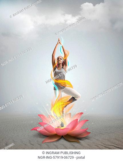 Silhouette young african woman practicing yoga in lotus flower