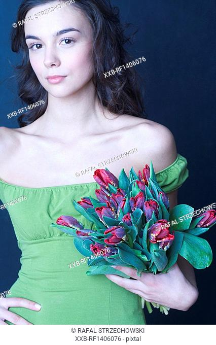 young woman with banch of tulips
