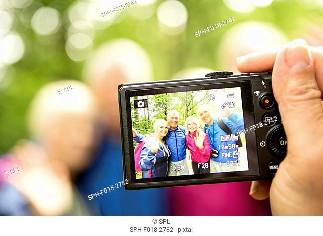 MODEL RELEASED. Person taking photo with digital camera