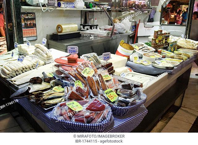 Fishmonger in the market hall of Mercat de la Boqueria, Barcelona, Spain, Europe