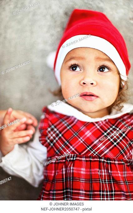 Small girl wearing Santa Clause hat