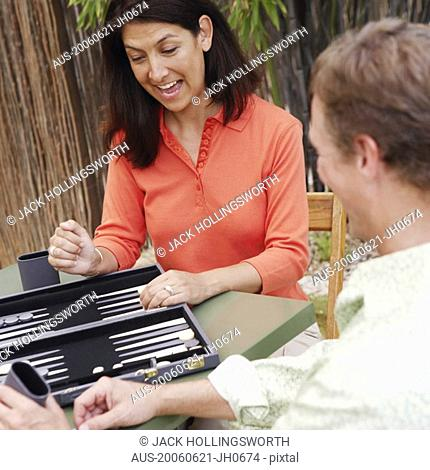 Mature couple playing backgammon