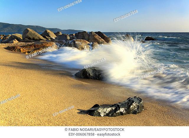 Waves splashing on a rock in Corsica