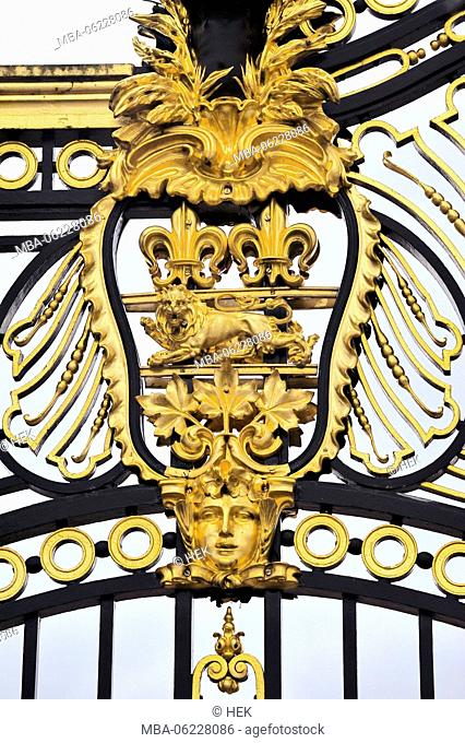 Royal Coat of Arms on the gate to Buckingham Palace in London