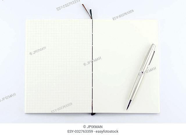 Opened notepad with pen on white background