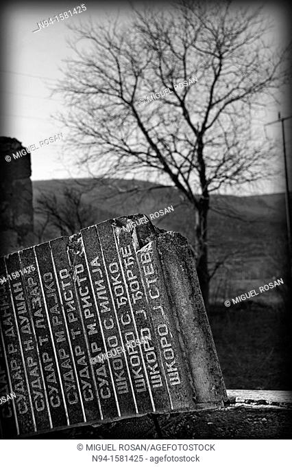 Remains of a monolith headstone in memory of those killed in the war in Bosnia