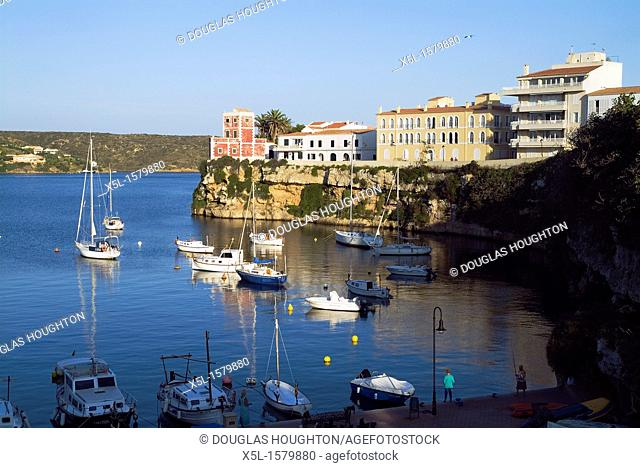 Cales Figuera ES CASTELL MENORCA Pleasure boats and yachts anchored in bay at quayside people fishing