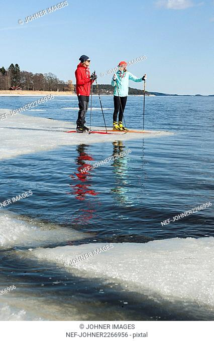 Man and woman standing on ice floe