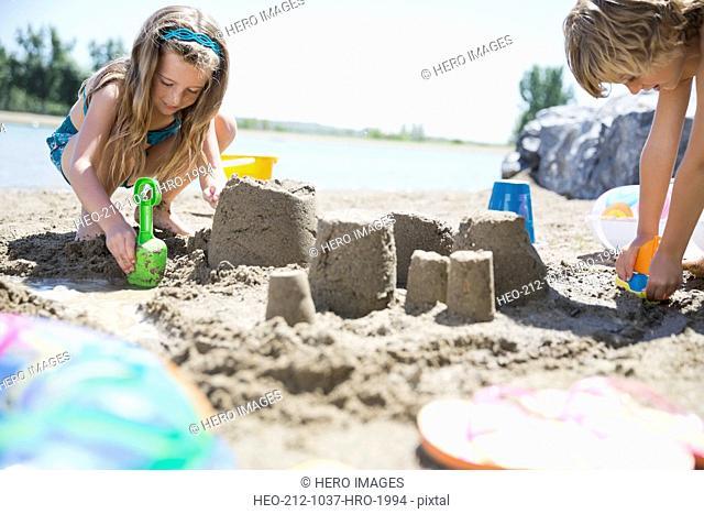 Siblings making sandcastles on the beach