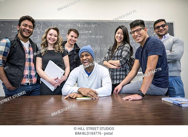 College students smiling in classroom