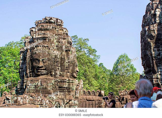 Stone head on towers of Bayon temple in Angkor Wat, Siem Reap, Cambodia