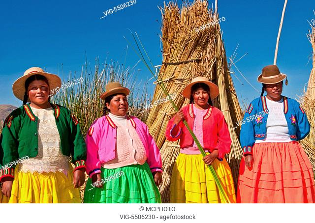 Lake Titicaca Peru with local traditional women of Uros Tribe history in colorful clothes near Puno - , 15/08/2008