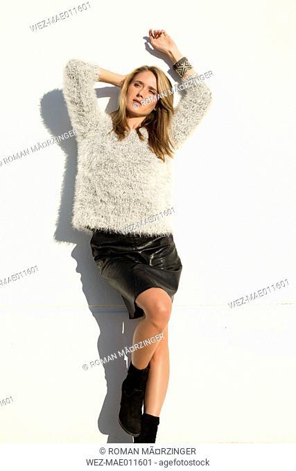 Attractive blond woman wearing mini skirt, portrait