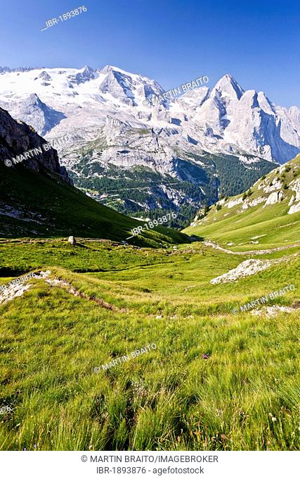 Near the Via Ferrata delle Trincee path, fixed rope route above the Fedaia pass, Gran Vernel mountain and Marmolada mountain at the back, Dolomites