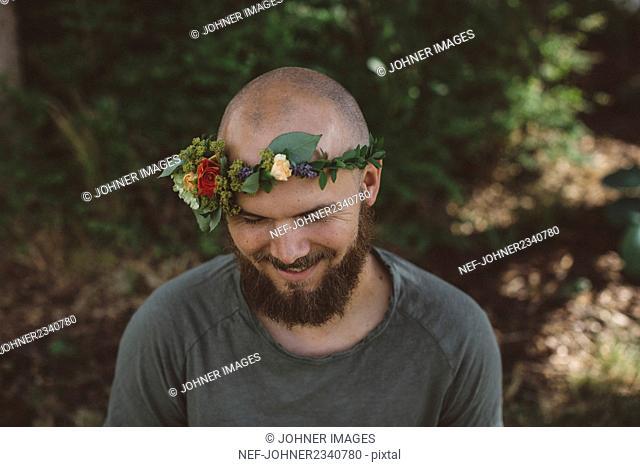 Man wearing flower wreath