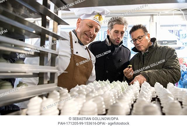 Pastry chef Johannes Becker from the State Association of bakers in Baden-Wuerttemberg (L-R), Tuebingen's Lord mayor Boris Palmer (from the Green party) and...
