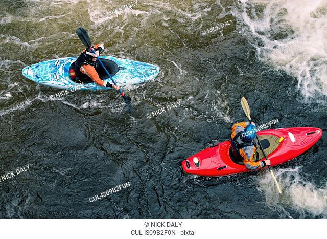 Overhead view of two kayakers paddling River Dee rapids