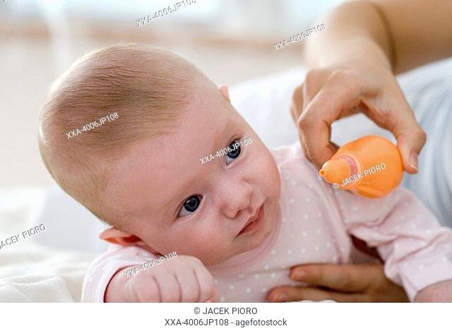 cleaning nose of newborn baby