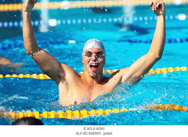 Swimmer Celebrating Success in Swimming Pool