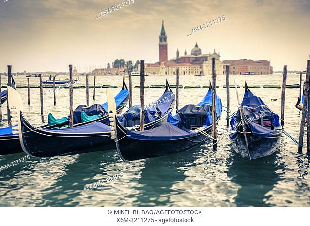 Gondolas and San Giorgio Maggiore Island. . St Mark's Square. Venice, Italy. Europe