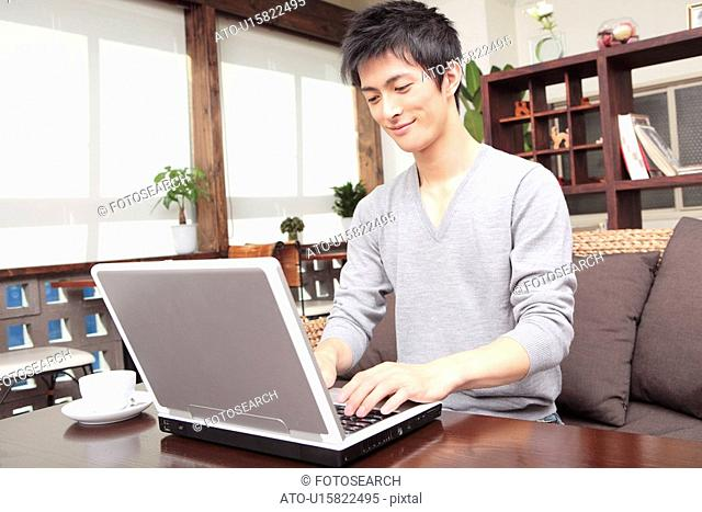 Man operating a PC