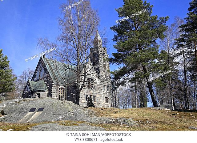 Karuna Church and bell tower in Karuna, Sauvo, South of Finland in spring. The church was built in 1908-10 in the style of Finnish National Romanticism
