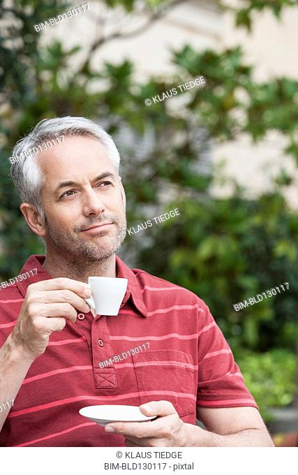 Man drinking espresso outdoors