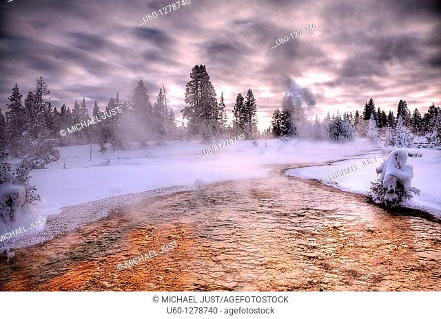 An unnamed hot spring produces vivid orange at the West Thumb Geyser Basin at Yellowstone National Park, Wyoming during winter