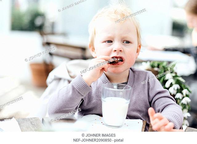 Girl eating chocolate cookie