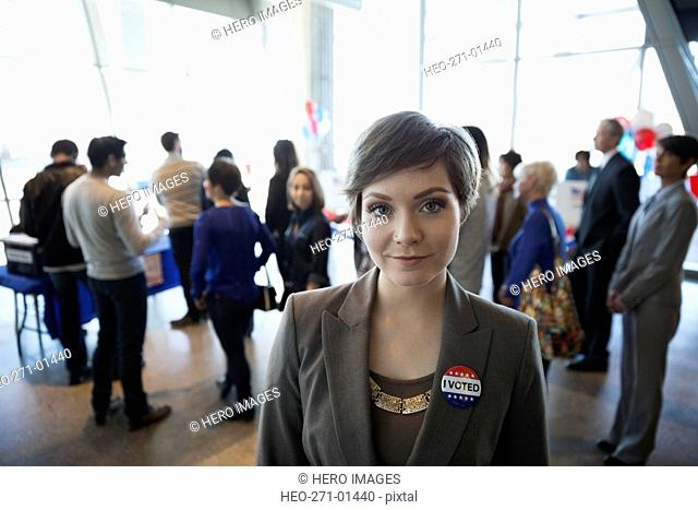 Portrait smiling young woman at voter polling place