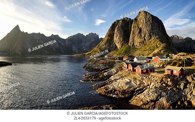 Norway, Nordland, Lofoten islands, Moskenesoy island, the fishing village of Hamnoy, traditional fishermen cabins built on stilts (rorbu, rorbuer) at sunset